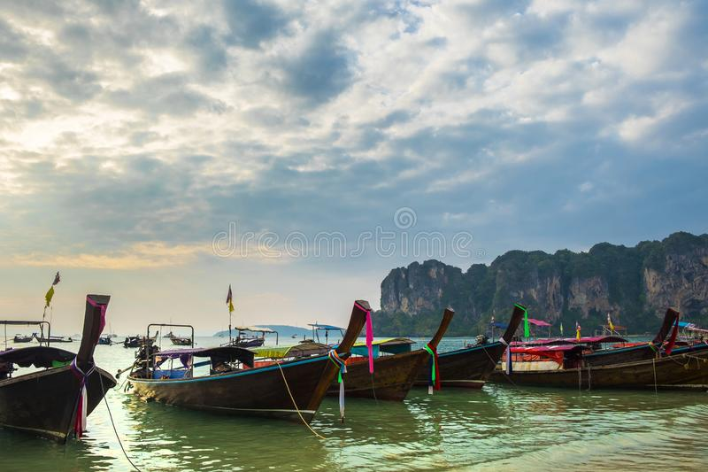 Thai traditional wooden longtail boats on Railay Beach in Krabi province. Thailand. royalty free stock photography