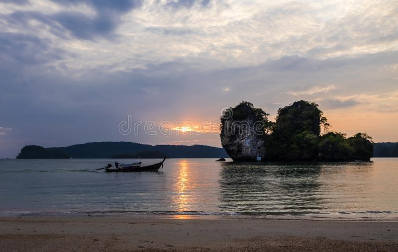 Thai traditional wooden longtail boats at the sunset in Krabi province. Thailand. stock image