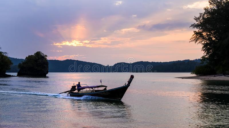 Thai traditional wooden longtail boats at the sunset in Krabi province. Thailand. stock photography