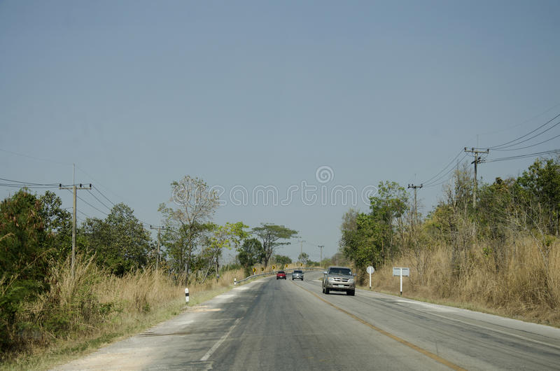Thai travelers people driving car at countryside road. From Dan Sai go to Phu Ruea National Park and Chiang Khan for visit and rest on February 21, 2017 in Loei stock photography