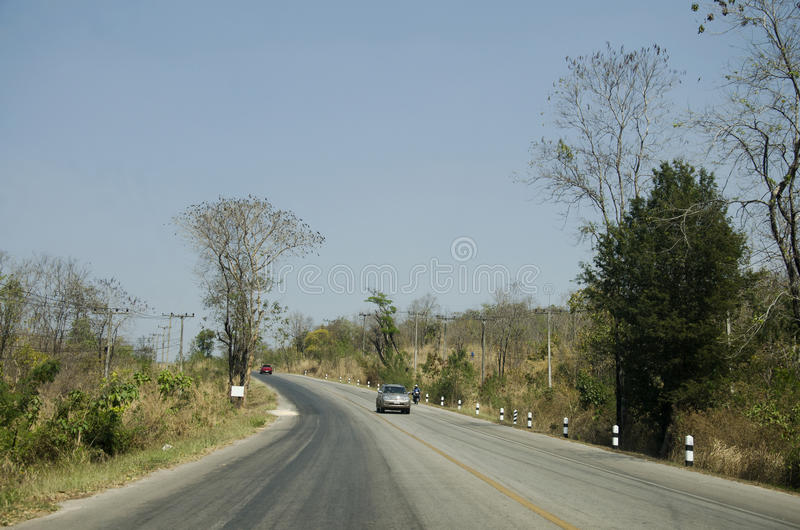 Thai travelers people driving car at countryside road. From Dan Sai go to Phu Ruea National Park and Chiang Khan for visit and rest on February 21, 2017 in Loei royalty free stock photo