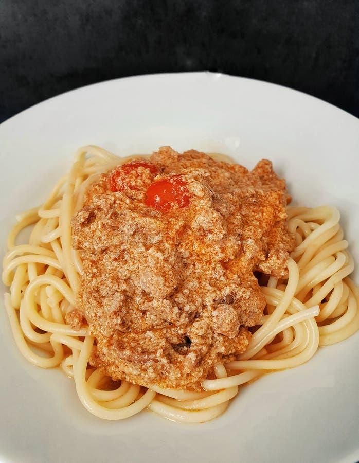Thai tuna curry with spaghetti, fusion thai and italian food, thai street food, Italian pasta royalty free stock photo