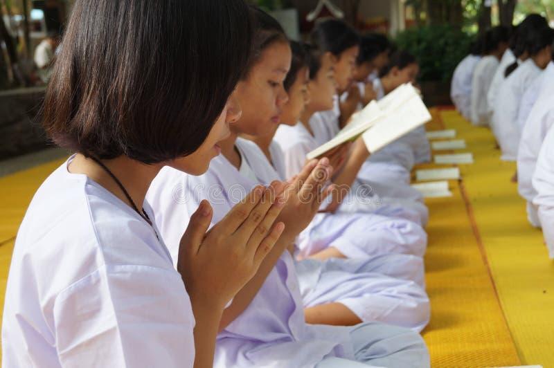 Thai unidentified people praying, Bangkok, Thailand. In Buddhist lent day royalty free stock image