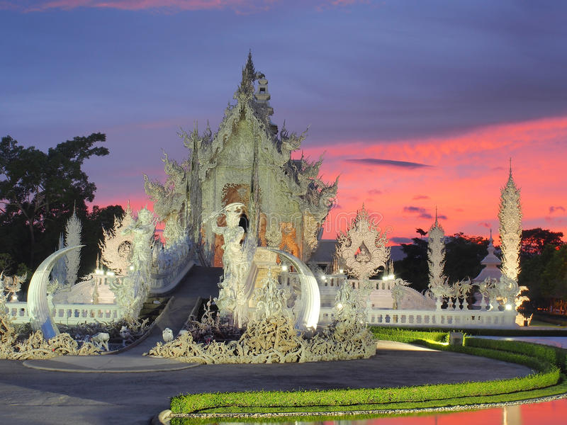 Thai Unique Temple (The White Temple) under amazed sky. Wat Rong Khun , The Thai unique temple (The White Temple) was under amazed sky, twilight time, Chiangrai royalty free stock photo