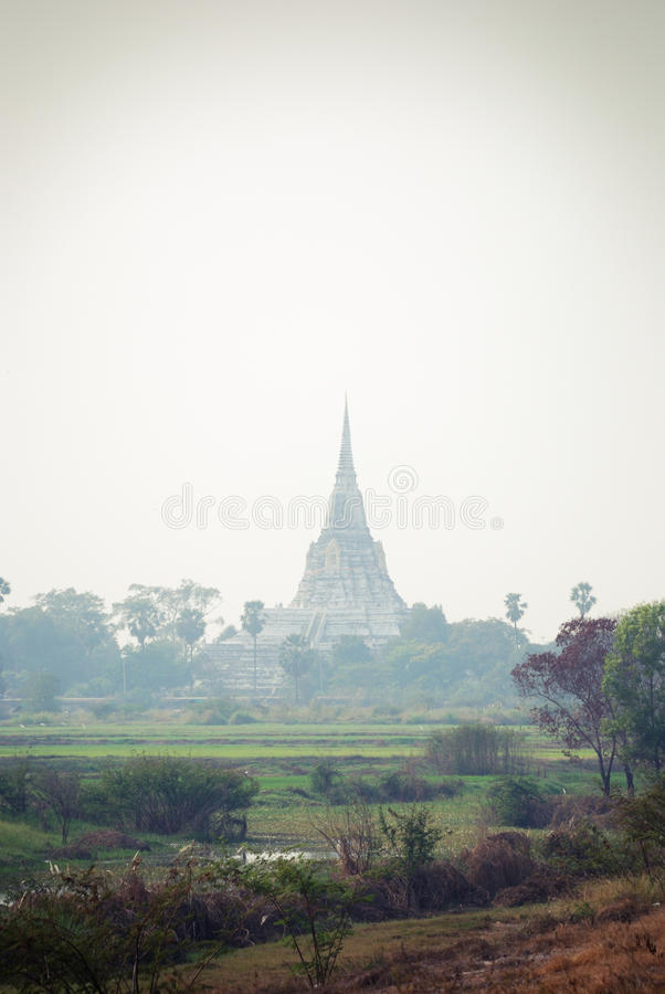 Thai view with Buddhist tower in the fog. stock image