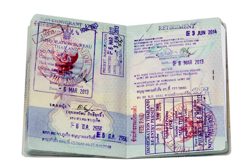 Thai visa stamps. Passport showing Thai non immigrant O visa, retirement visa and re-entry permit.immigration, validity royalty free stock photography