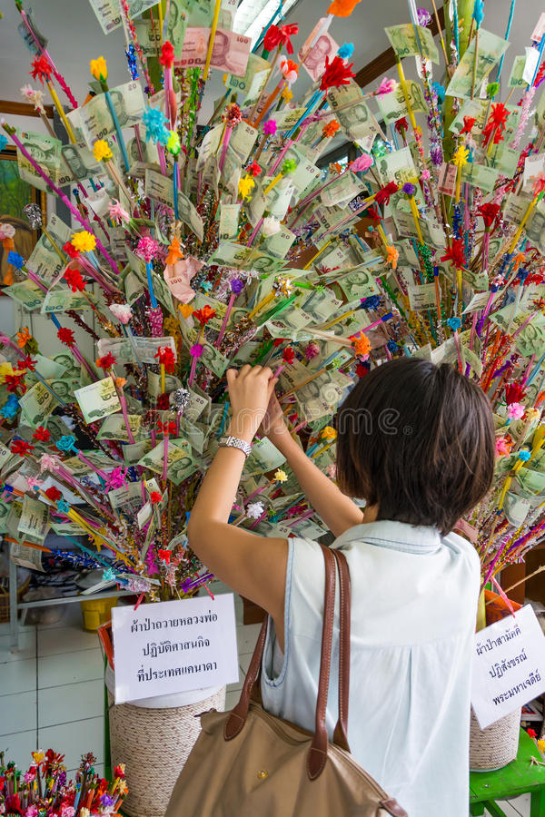 Thai Woman Donating In The Donation Tree In Visakh Royalty Free Stock Photography