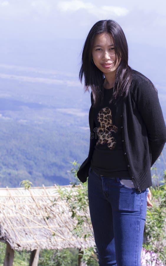 Thai woman portrait with mon jam mountain, maerim chiangmai. Thai woman portrait with mon jam mountain , maerim chiangmai royalty free stock photo