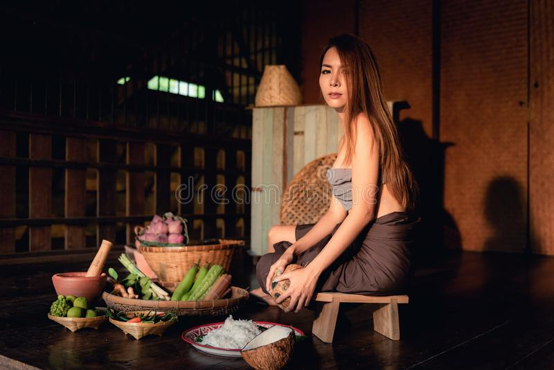 Thai woman is providing ingredient for cooking in the evening. stock image