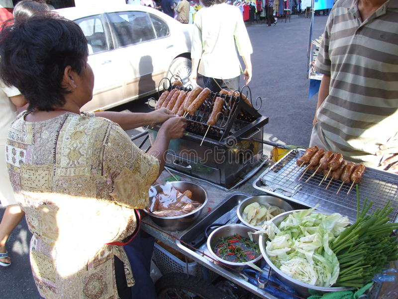 Download Thai Woman Selling Cooked Sausages, Thailand. Editorial Photo - Image: 14936666