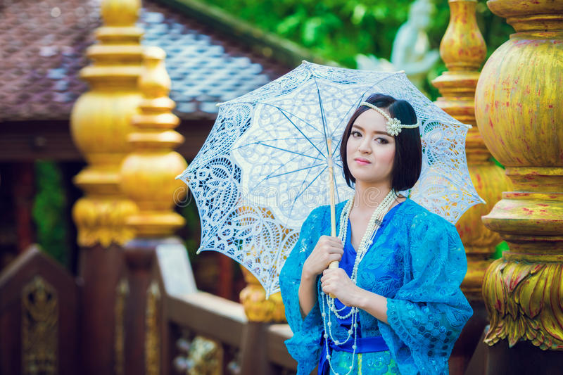 Thai woman wearing typical Thailand traditional dress at house ( royalty free stock photos