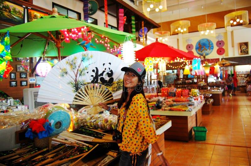 Thai women holding paper fan with Handmade Art Umbrella at Bo-sang Village stock photos