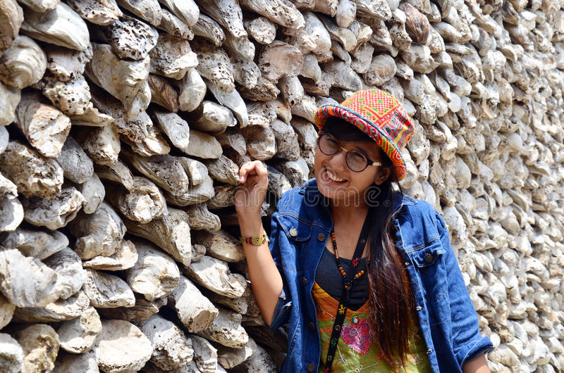 Thai women portrait with Oyster Shell wall in Wat Chedi Hoi royalty free stock image