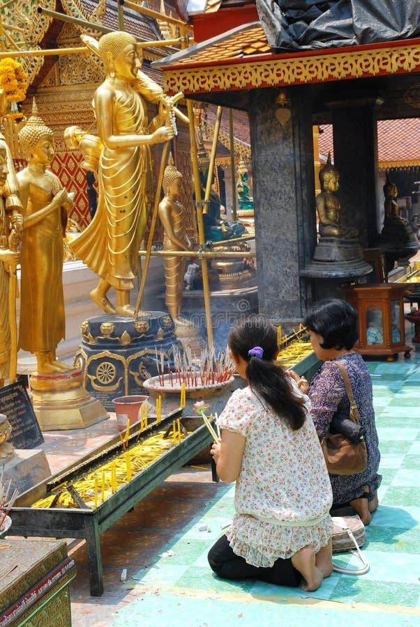 Thai women praying stock images