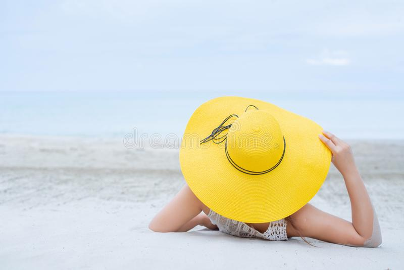 Thai Women travel alone at the sea and beach royalty free stock image