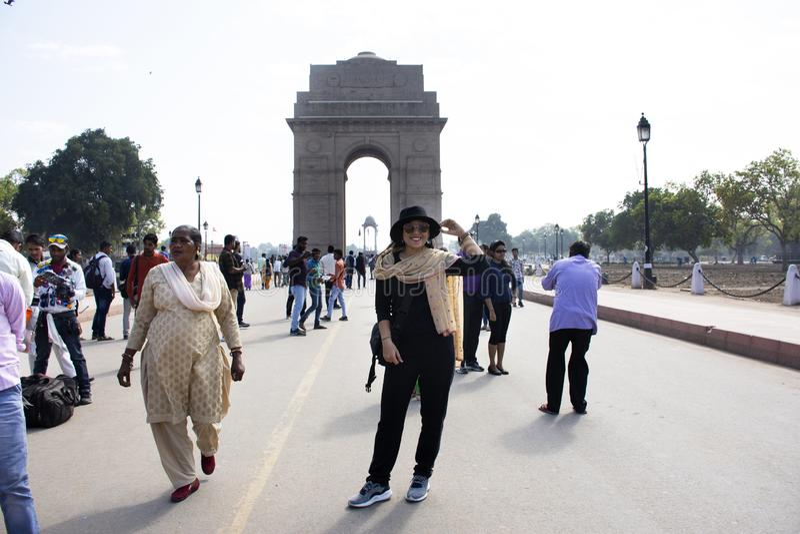 Thai women travel and posing take photo india Gate originally called the All India War Memorial at city of Delhi, India stock photos