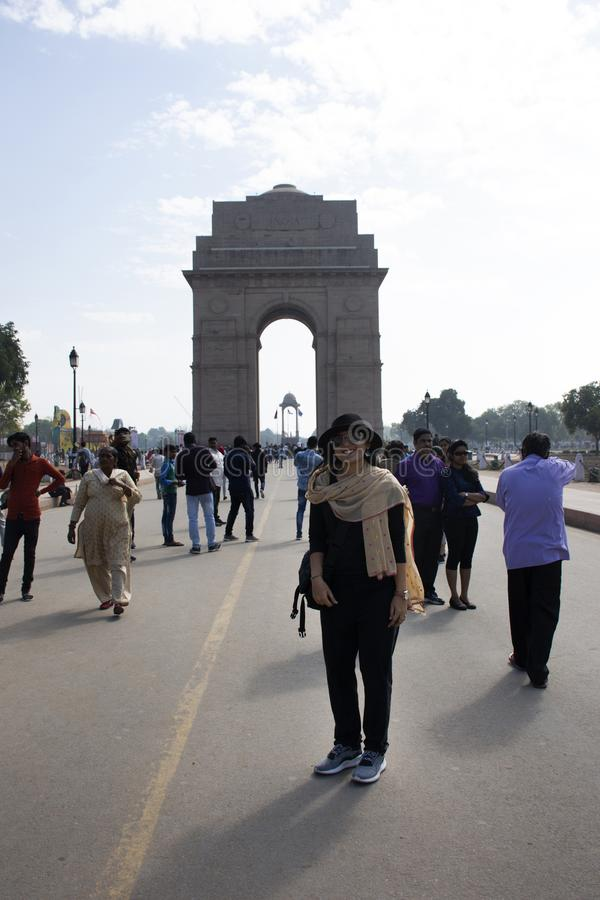 Thai women travel and posing take photo india Gate originally called the All India War Memorial at city of Delhi, India stock photography