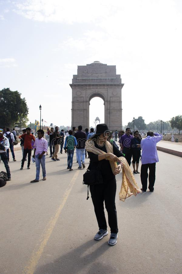 Thai women travel and posing take photo india Gate originally called the All India War Memorial at city of Delhi, India royalty free stock images