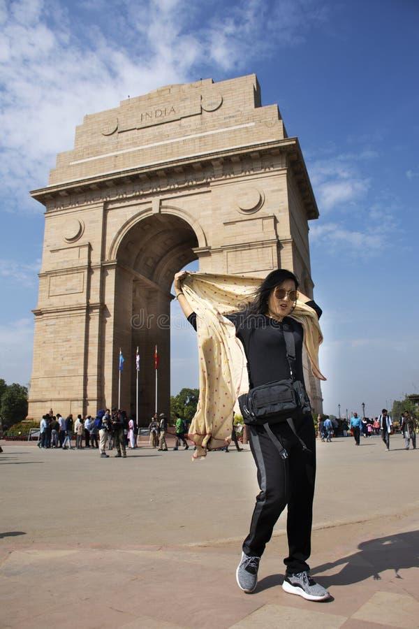 Thai women travel and posing take photo india Gate originally called the All India War Memorial at city of Delhi, India stock image