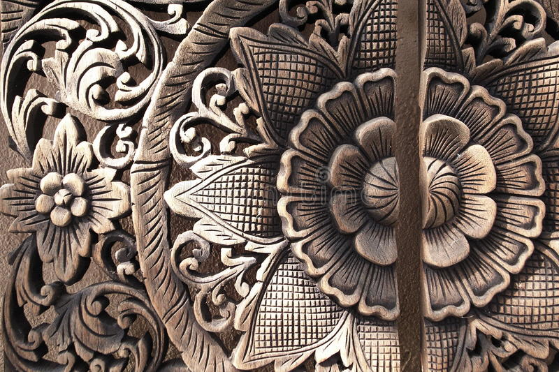 Thai wood craving. Traditional Thai wood craving in flower shape royalty free stock photography