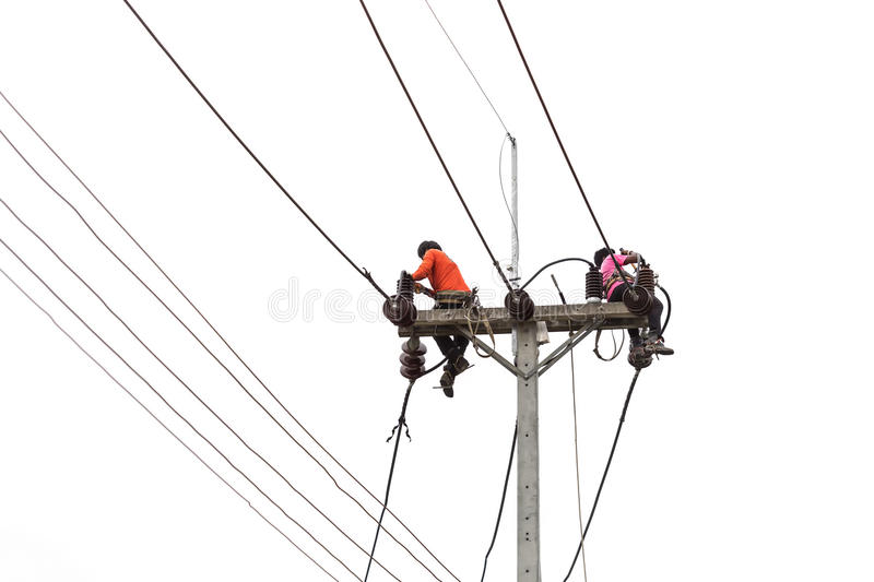 Thai worker on electric pole for install new cable isolated on w royalty free stock photos