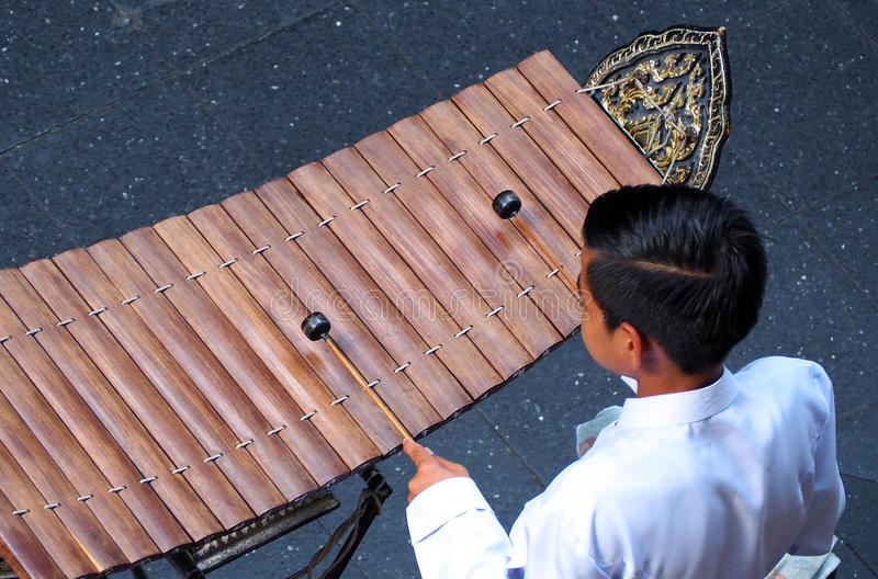 Thai xylophone played by thai people. Thai xylophone played by thai people who weared white vintage traditional suit and top view camera stock photos