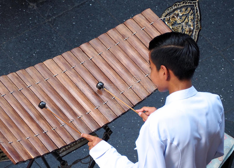 Thai xylophone played by thai people. Thai xylophone played by thai people who weared white vintage traditional suit and top view camera royalty free stock photo