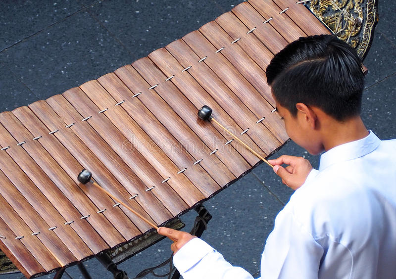 Thai xylophone played by thai people. Thai xylophone played by thai people who weared white vintage traditional suit and top view camera stock photo