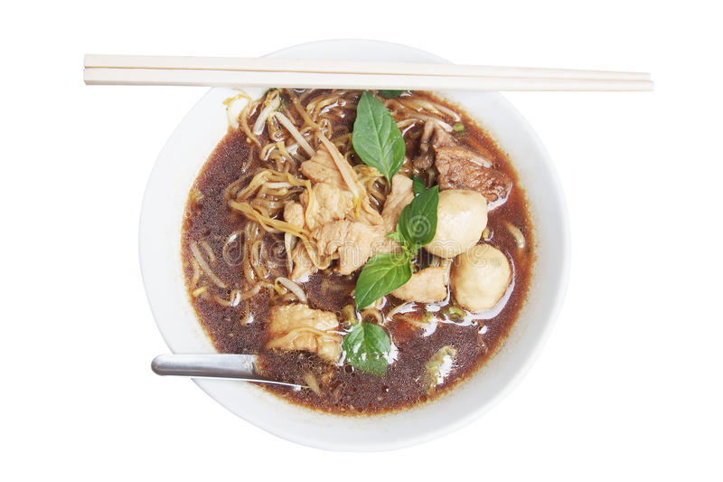 Thai yellow noodle soup with meat ball stock photography