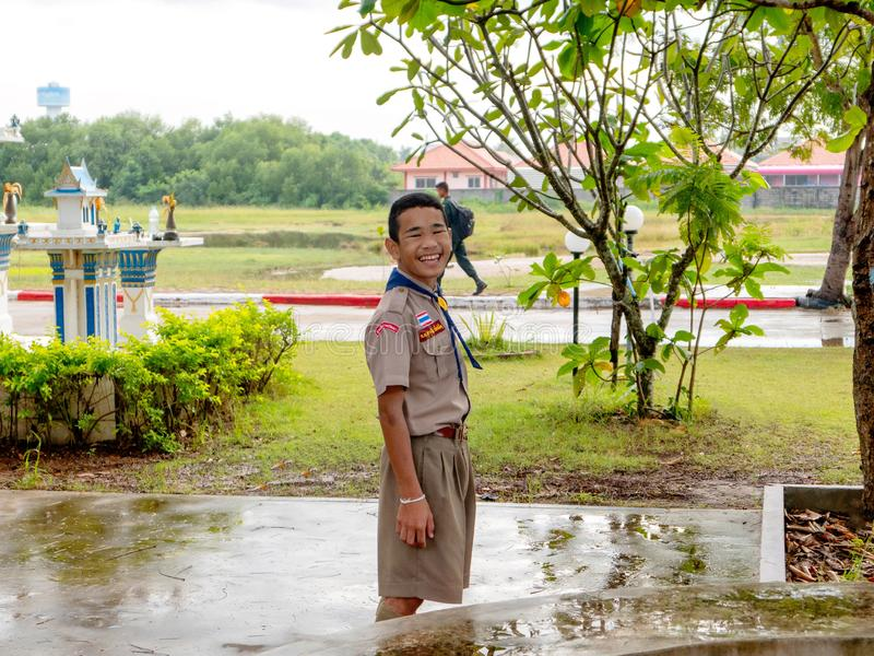 A thai yyoung student in boy scout uniform standing and smiling to the camera at his school. Hua Hin, Thailand Agust 11, 2017 stock images
