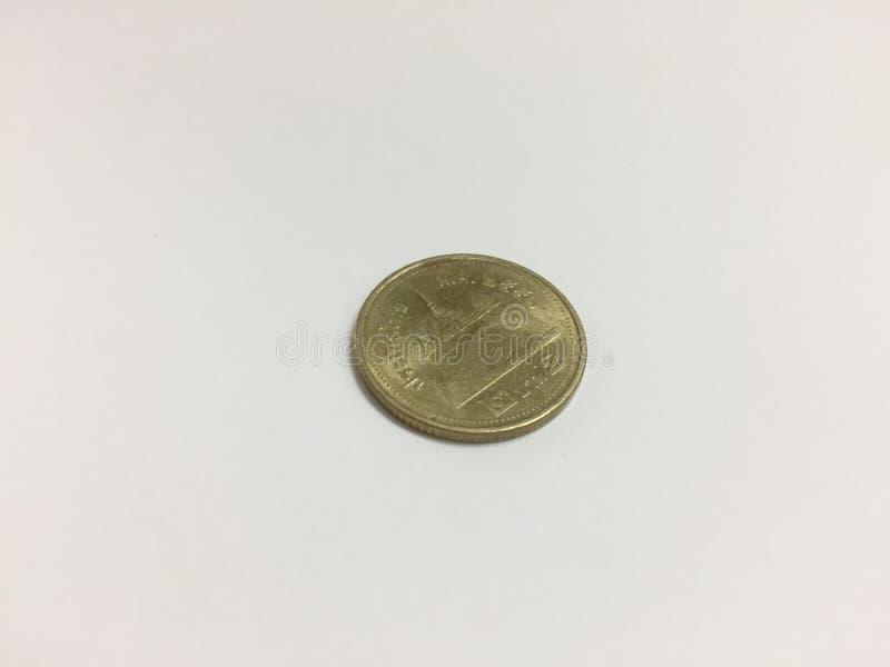 Thailändische Münze von Bad 2 auf einem weißen Hintergrund stockfotos