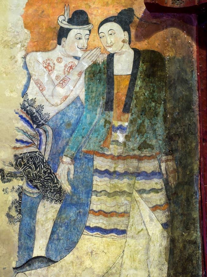 Thailändsk konstväggmålning i strömförsörjningskyrka av Wat Phu Mintr royaltyfria foton