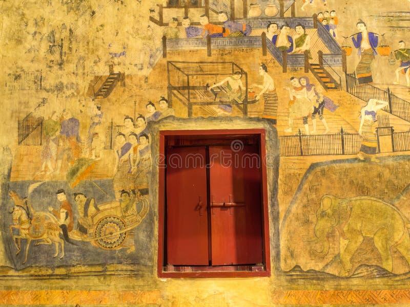 Thailändsk konstväggmålning i strömförsörjningskyrka av Wat Phu Mintr fotografering för bildbyråer