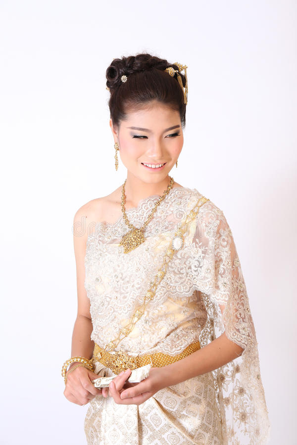 Thailändsk kvinnlig i traditionell klänning arkivbild