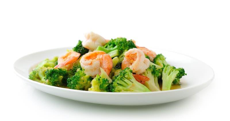Thailändsk sund mat stekt under omrörning broccoli med räka arkivbild