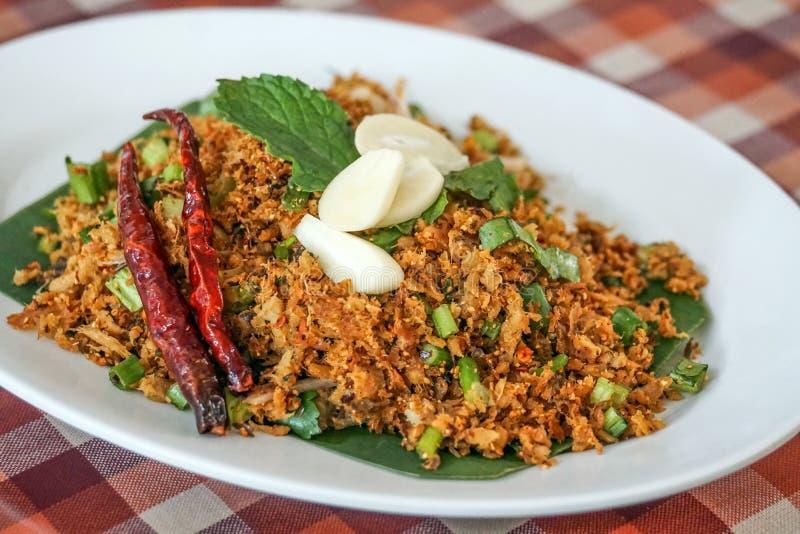Thailändska kryddiga sura örter för grisköttandsallad royaltyfri bild