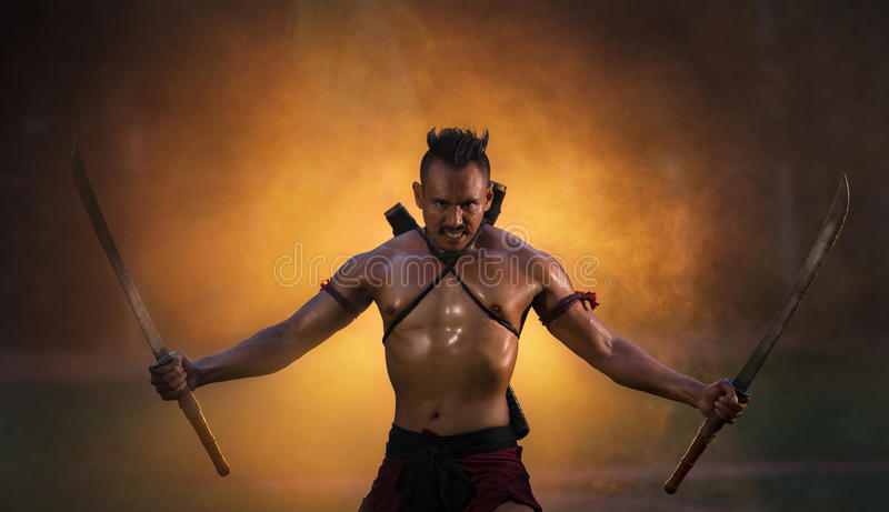THAILAND Ancient warrior holding swords ready fighting royalty free stock images