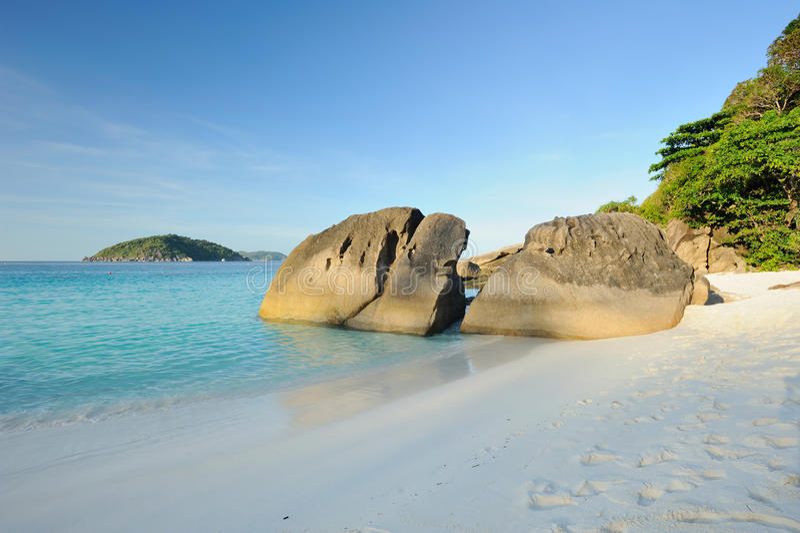 Thailand. Andaman sea. Similan islands. Sand beach. Calm blue sea, splendid green and big stones stock images