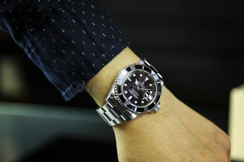 Thailand - AUGUST 19, 2018: luxury watches Rolex on his hand. Rolex luxury watch - Image watches in Thailand, AUGUST 19, 2018 royalty free stock images