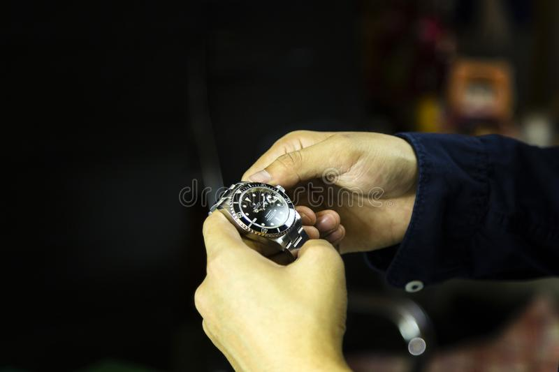Thailand - AUGUST 19, 2018: luxury watches Rolex on his hand. Rolex luxury watch - Image watches in Thailand, AUGUST 19, 2018 royalty free stock photography