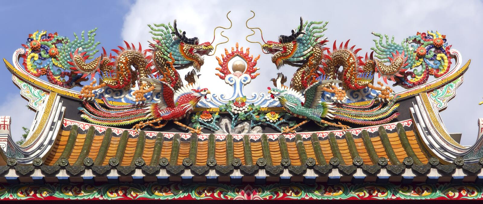 Thailand, Bangkok: Chinatown, temple. Thailand, Bangkok: temple in Chinatown; detail of the roof; temple with a typical mythological dragon royalty free stock photography