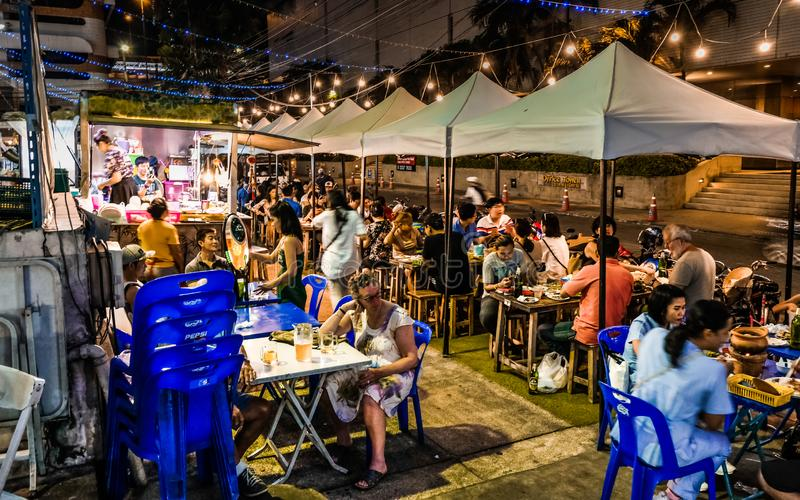 Makeshift Street Food Open Restaurant At Night In Bangkok, Thailand, Southeast Asia. Street food is everywhere in Bangkok, you can find them in almost every stock images