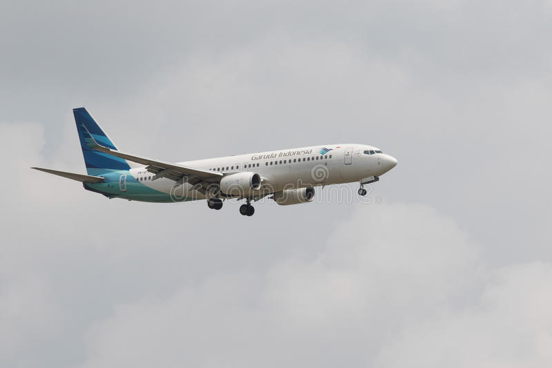THAILAND,BANGKOK-MAR 3:Garuda Airline plane flying above suvarnabhumi airport runway and prepare to landing in bangkok on march stock photos
