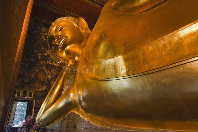 Thailand, Bangkok, Pranon Wat Pho. Laying Buddha golden statue royalty free stock photos