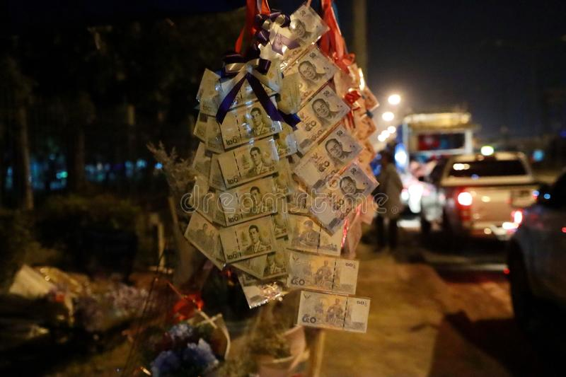 Thailand banknotes sewn continuously is favorable to the neck for congratulation with street lighting stock image