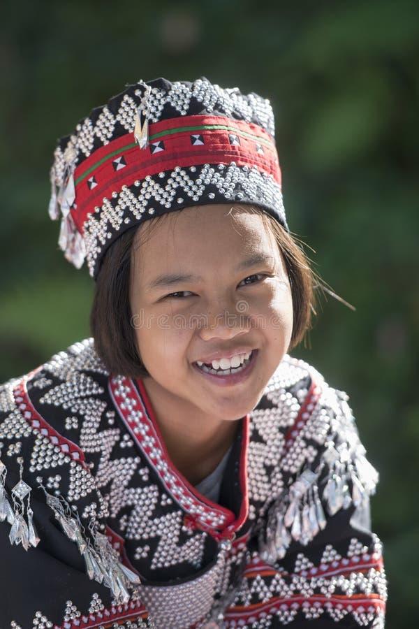 THAILAND CHIANG RAI DOI TUNG AKHA HILL TRIBE. A Ahka hill Tribe Girl at the Mae Fah Luang ornamental garden at the village of Doi Tung north of the city of royalty free stock photography