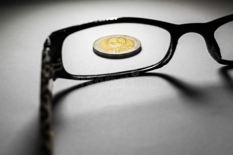 Thailand coins and glasses. royalty free stock photo