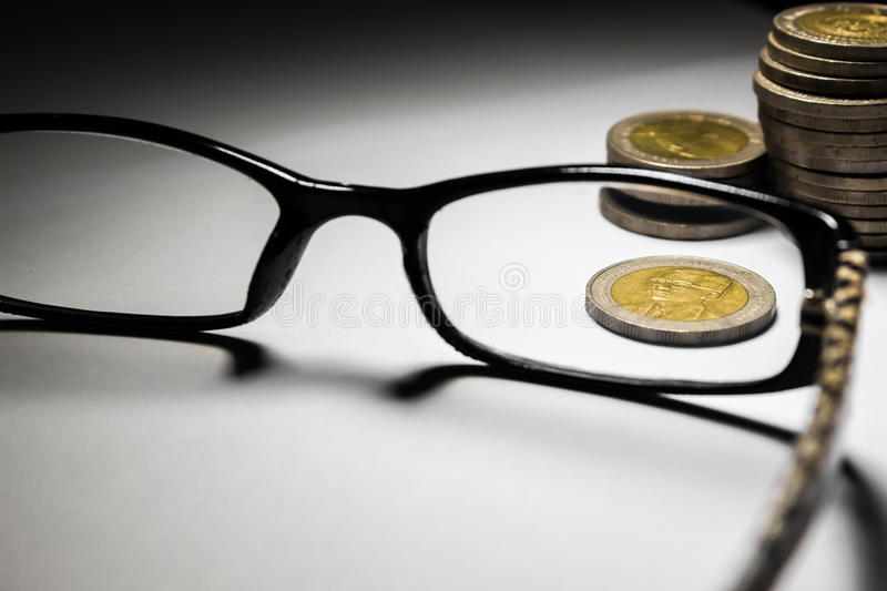 Thailand coins and glasses. royalty free stock image