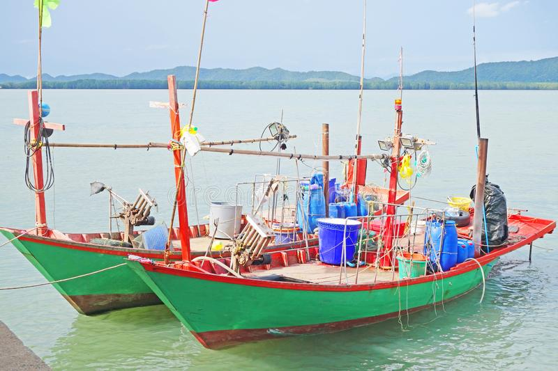 Thailand country wooden fishing boat on a sea stock image