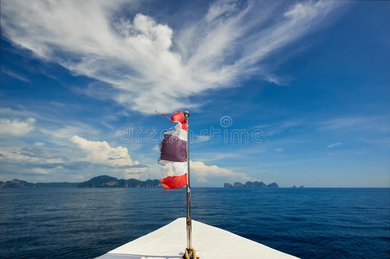 Thailand flag with boat sails to Koh Phi Phi island, Thailand. XXL stock photography